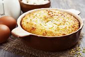 stock photo of millet  - Casserole with millet and curd on the wooden table - JPG