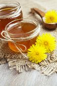 stock photo of jar jelly  - Jelly of dandelions in a glass jar on the table - JPG