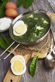 image of sorrel  - Sorrel soup with egg on wooden table - JPG