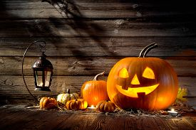 picture of jack o lanterns  - Halloween pumpkin head jack lantern on wooden background - JPG