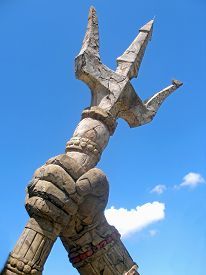 stock photo of trident  - A stone trident with sky and clouds - JPG