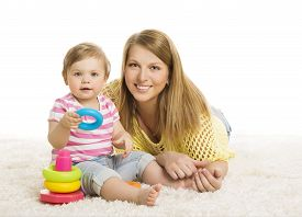 picture of child development  - Baby and Mother Kid Playing Blocks Toy Early Children Development Toys Young Family and Little Child one year old - JPG