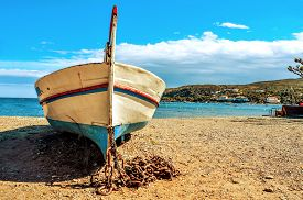 pic of shingles  - closeup of an old fishing boat stranded on a shingle beach in Cadaques - JPG