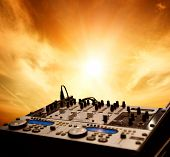Dj mixer over sky background
