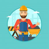 A hipster builder in helmet giving thumb up. A builder with thumb up on a construction site. A man g poster