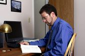 Middle-Aged Man Working In A Home Office