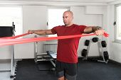 Man Exercising With A Resistance Band poster