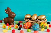 Easter Conceptual Image On Blue Wooden Background With Copyspace Chocolate Easter Rabbit, Candy, Swe poster
