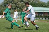 KAPOSVAR, HUNGARY - SEPTEMBER 5: Janos Balogh (white 10) in action at the Hungarian National Championship under 17 game Kaposvar (white) vs. Nagyatad (green) September 5, 2011 in Kaposvar, Hungary.