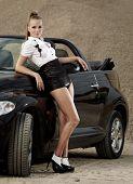 Fashion  vintage woman with cabrio car