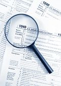 stock photo of income tax  - Tax forms investigation concept with magnifying glass and 1040 US Income Tax Return