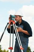 One surveyor worker with theodolite equipment outdoors