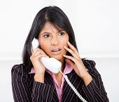businesswoman shocked by phone call