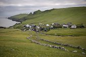 Houses and stone wall in the village of the Island Mykines, Faroe Islands