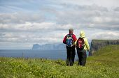 Couple hiking on Mykines, Faroe Islands
