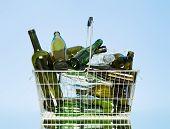 Glass Bottles In A Wastebasket