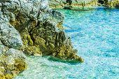Crystal Clear Sea Water At Summer Travel Destination Croatian Mediterranean Beach. poster