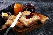 Toast Bread With Homemade Strawberry Jam And Orange Marmalade On Rustic Table Served With Butter For poster