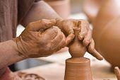 Potter's Hands Working.