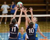 KAPOSVAR, HUNGARY - APRIL 24: Zsanett Pinter (R) strikes the ball at the Hungarian NB I. League woma