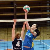 KAPOSVAR, HUNGARY - APRIL 24: Gabriella Kondor (R) strikes the ball at the Hungarian NB I. League woman volleyball game Kaposvar (blue) vs Ujbuda (black), April 24, 2011 in Kaposvar, Hungary.