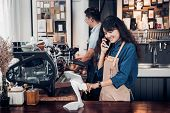 Asia Barista Waiter Use Tablet Take Order From Customer In Coffee Shop,cafe Owner Writing Drink Orde poster