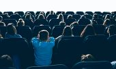 Great Ammount Of People Watching Movie In Big Cinema Hall, Sitting On Comfortable Places. Backview O poster