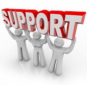 Three people lift the word Support symbolizing the help a group of selfless volunteers can provide i