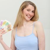 Happy Woman With Cash From Business Turnover