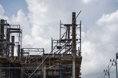 Building And Construction Site In Progress. Building Construction Site Against Cloudy Sky. Metal Con poster