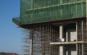 Building And Construction Site In Progress. Building Construction Site Against Blue Sky. Metal Const poster