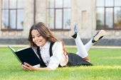 Read Every Day. Cute Small Child Read Library Book On Green Grass. Adorable Little Girl Learning To  poster