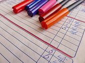 Paper Diary Of A Second Grade Student. Markers For Drawing Lie On The Diary. Primary School. Retro.  poster