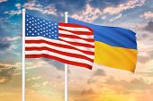 Relationship Between The Usa And The Ukraine. Two Flags Of Countries On Heaven With Sunset. 3d Rende poster