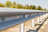 White Road Reflectors Along The Road. Metal Road Fencing Of Barrier Type, Close-up. Road And Traffic poster