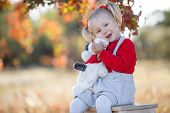 Little Fashionista. Happy Girl On Autumn Day. Little Girl Happy Smiling With Autumn Leaves. Girls Au poster