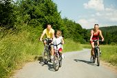 picture of family fun  - family having riding their bicycles  - JPG