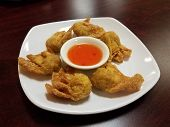 Plate With Fried Wontons And Sweet And Sour Sauce poster