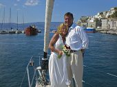 picture of hydra  - Newly wed couple getting married on a sailboat in the port of Hydra in Greece.