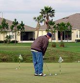Golfer On Putting Green