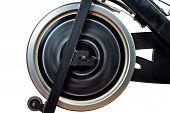 Aged Spinning Bike Flywheel Rotating. Front Detail.