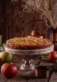 French Sweet Pie Tart Tatin Apple Cake Upside Down And Fresh Apples  Over On Old Rustic Wooden Backg poster