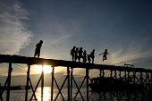 Children playing at jetty