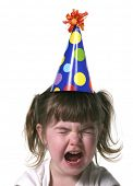 image of fussy  - Child Throwing a Tantrum Wearing a Birthday Hat - JPG