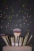 Set Of Brushes And Cosmetic Products In A Cosmetic Bag On A Grey Background poster