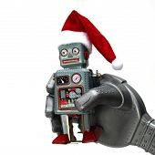 The Robot Holds A Small Retro Robot In His Hand. poster