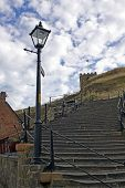 Low angle view of 199 steps leading up to Saint Marys Church and Whitby Abbey, North Yorkshire, England.