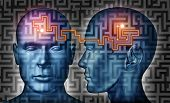 stock photo of neurology  - Communication solutions and mind control with a group of communicating human heads on a labyrinth or maze pattern with a laser light connecticn the thinking network of two brains - JPG