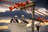 image of lineman  - Electricians on a crane - JPG