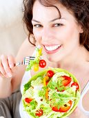 Diet. Dieting concept. Healthy Food. Beautiful Young Woman Eating Vegetable Salad. Vegan